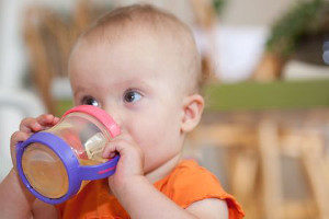 cute baby drinking from a squat and wide sippy cup