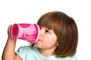 toddler drinking from a silicone sippy cup