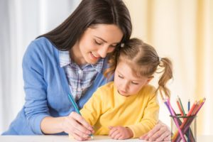 mom and her kid taking notes to determine how to choose the right babysitter