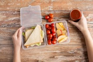 clear lunch box similar to a bento lunch box with three compartments and two lids