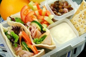 standard plastic lunch box that is not quite as well organized as bento lunch boxes can be
