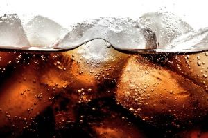 a picture of soda and ice cubes since healthy alternatives to soda are being discussed
