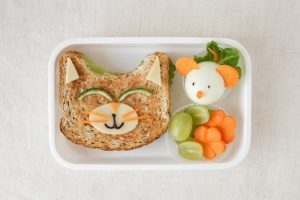 a sandwich along with vegetables as sides as a DIY lunchable in a bento lunch box that is BPA-free