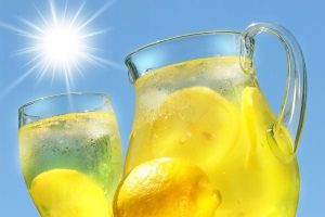 cold glass of lemonade for kids to drink on a hot summer day