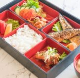 a bento lunch box that highlights the perfect idea of a healthy lunch for kids when they go off to school in a hurry