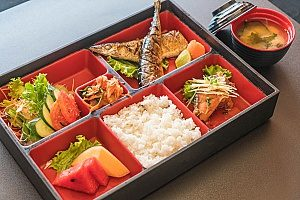 an image of bento lunch boxes that are used for children and adults to take on the go while keeping their food fresh and warm or cold