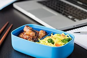 a bento lunch box that a woman is using at work since she bought one for her and her kids