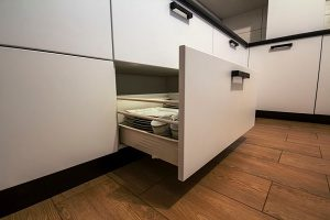 deep drawer containing organized dish ware and bento lunch boxes