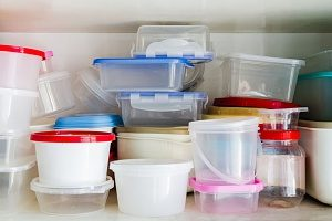 overflowing dishware drawer that is about to be replaced with bento lunch boxes