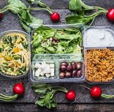 a selection of healthy foods stored in eco friendly plastics such as bento lunch boxes