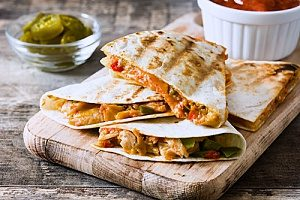 chicken and cheese quesadillas made in under ten minutes to be stored in a reputable lunch box made by a bento lunch box company
