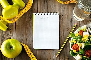 a food diary being kept by a man for his New Year's fitness resolution