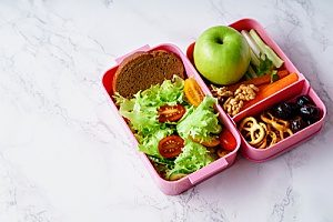 bento lunch boxes used as a part of a woman's New Year's fitness resolution