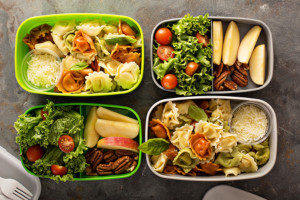 Four bento lunch boxes packed for adults