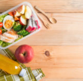 A healthy lunch packed in a clear bento lunch box