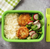 vegan recipes inside of a green bento box