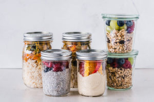 multiple glass storage containers that are bpa free filled with food