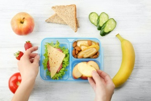 a lunch being put into a Bento Lunch Boxes