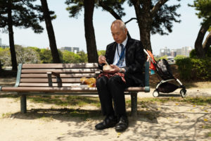 man eats out of his bento box during his lunch break