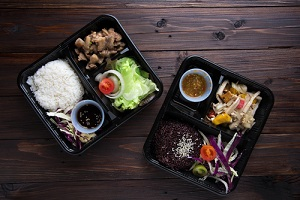 freshly served bento box on wooden table
